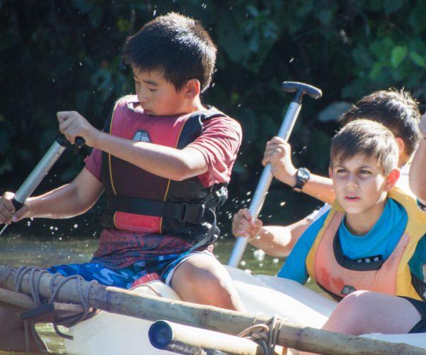 Students atop a Raft Build at Hunua Falls