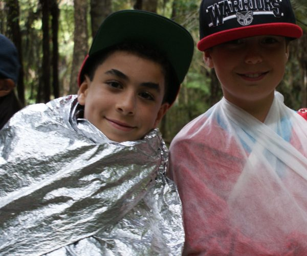 Two participants one in a sling and one in a space blanket