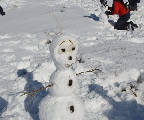 Snowman built by participants as part of Mountain Experience programme for schools