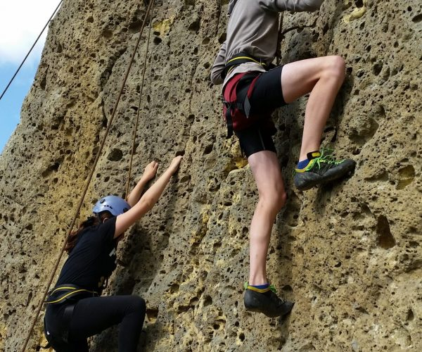 Two climbers scaling a climb at CastleRock Adventure in Wharapapa South